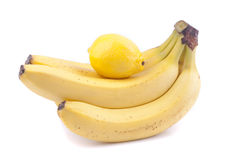Bananas and lemon. Bananas and lemon on a white background Royalty Free Stock Photo