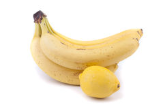 Bananas and lemon. Bananas and lemon on a white background Royalty Free Stock Images