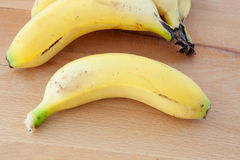 Bananas located on a wooden surface Royalty Free Stock Images