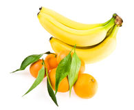 Bananas and mandarines Stock Photos