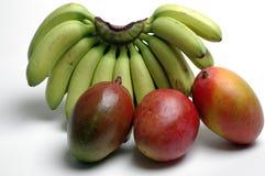 Bananas and mangoes Stock Photos