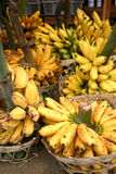 Bananas at the market. Bunches of bananas in baskets, for sale at the market Royalty Free Stock Photo