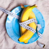 Bananas with measure tape Stock Images