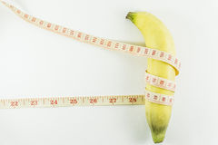 Bananas and measuring tape Stock Image