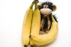 Bananas with monkey. Ceramics monkey with ripe bananas Royalty Free Stock Photos