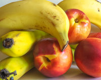 Bananas and Nectarines. Some mixed fresh fruit - bananas and nectarines Royalty Free Stock Photo