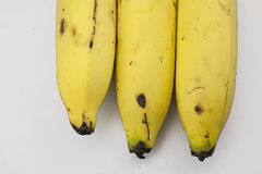 Bananas Next to Each Other. Isolated in white background Royalty Free Stock Images