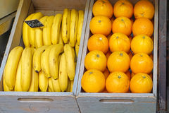 Bananas and oranges. Crates with bananas and oranges fruits Stock Images