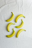 Bananas over white cloth Stock Image