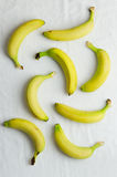 Bananas over white cloth Royalty Free Stock Image