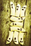 Bananas with painted chocolate faces Stock Photography