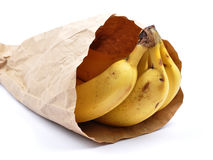 Bananas in paper bag Stock Image