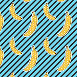 Bananas pattern on stripes background. Seamless Pattern. Pop art color. Print texture. Fabric design. Royalty Free Stock Photo