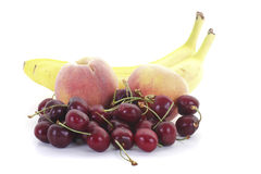 Bananas Peaches and Cherries Stock Images