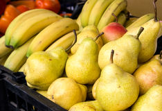 Bananas and pears on the counter market Royalty Free Stock Images