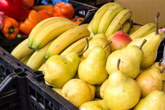 Bananas and pears on the counter market Royalty Free Stock Photography