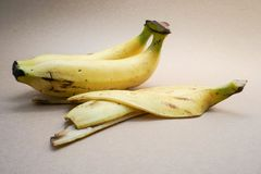Bananas with the peel. Close up bunch of bananas with the peel in brown background Stock Photography