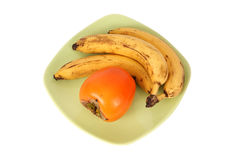 Bananas and persimmons Stock Image