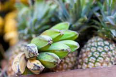 Bananas and pineapple on market Royalty Free Stock Image