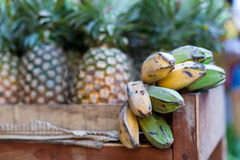 Bananas and pineapple on market Royalty Free Stock Photo