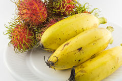 Bananas and rambutans Royalty Free Stock Photos