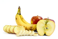 Bananas and ripe apples whole and sliced Royalty Free Stock Photography