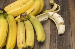 Bananas. Ripe and fresh bananas, yellow bananas on the table Royalty Free Stock Images