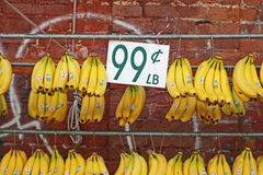 Bananas for Sale. Hanging on pole with sign at an outdoor market in Chinatown in Honolulu, Hawaii Stock Images