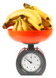 Bananas on scales Stock Photo
