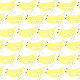 Bananas seamless vector background. In abstract style with green hand-painted spots Royalty Free Stock Photos
