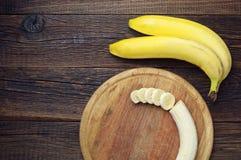 Bananas and a sliced Royalty Free Stock Photo