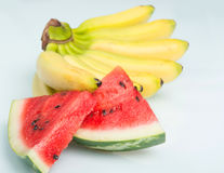 Bananas with slices of juicy watermelon Royalty Free Stock Photography