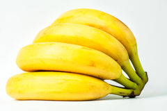Bananas. Sprig of bananas. ripe yellow delicious tasty bananas. yellow bananas on a white background Royalty Free Stock Image
