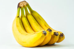 Bananas. Sprig of bananas. ripe yellow delicious tasty bananas. yellow bananas on a white background Stock Photography