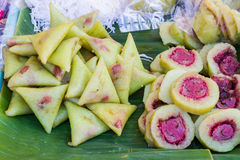 Bananas with sticky rice on green banana leaf on thai market. Royalty Free Stock Images