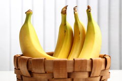 Bananas in basket. Bananas in a straw basket royalty free stock photography