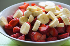 Bananas and strawberries royalty free stock image