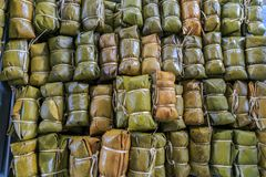 Bananas with sweet Sticky Rice covered in banana leaf on the tra. Y Royalty Free Stock Photography