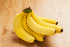 Bananas on table. Bananas put on woody table Stock Image