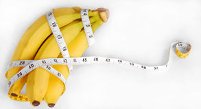 Bananas and Tape Measure Royalty Free Stock Photos