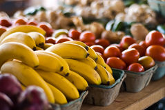 Bananas, Tomatoes, and More!. Baskets of bananas, tomatoes and more Royalty Free Stock Photos