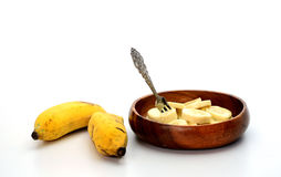 Bananas topped with milk on white background Royalty Free Stock Photos