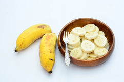Bananas topped with milk on white background Royalty Free Stock Images