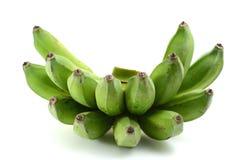 Bananas verdes Fotos de Stock