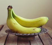 Bananas in vintage bowl Royalty Free Stock Photos