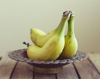 Bananas in vintage bowl Stock Image