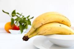 Bananas on white plate Stock Photos