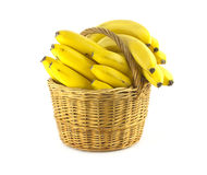 Bananas in wicker basket isolated Royalty Free Stock Images