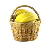 Bananas in wicker basket isolated Stock Photos