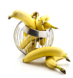 Bananas in wire fruit basket Stock Photo
